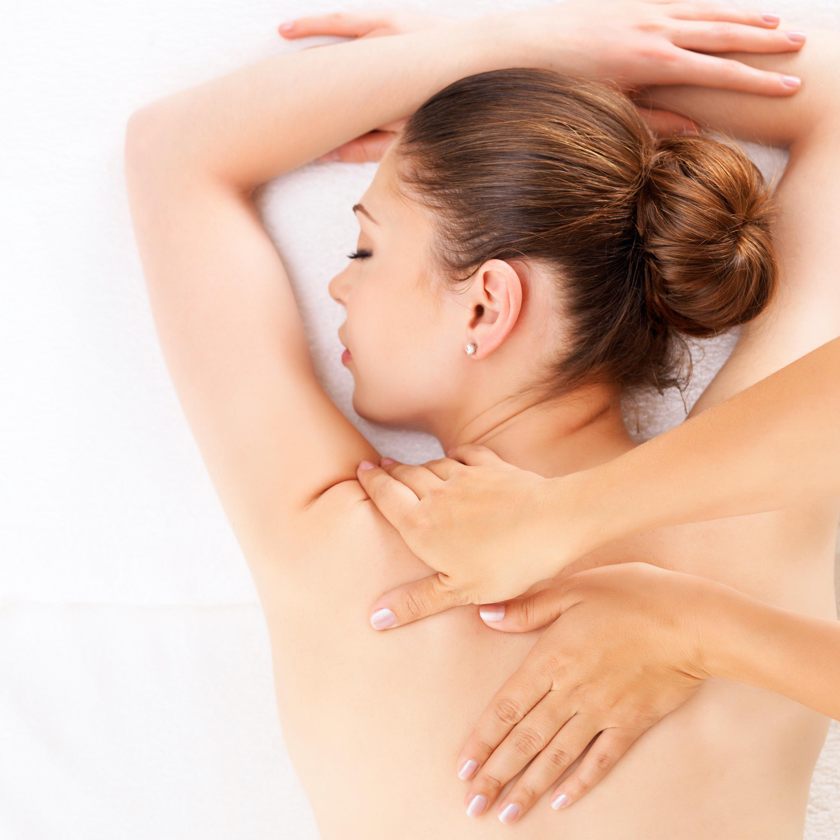 woman getting massage spa 6th